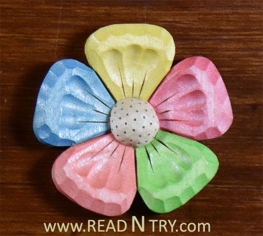 Wood carved magic flower read n try